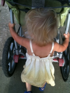 Happy with a purpose: pushing the stroller!