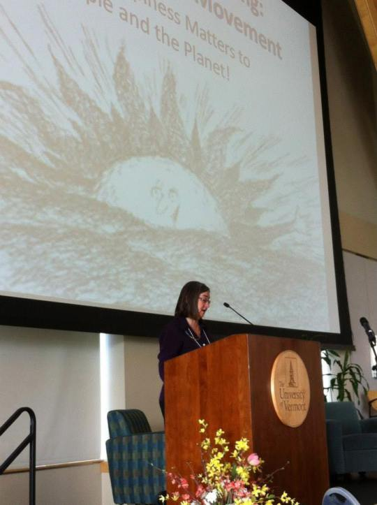Ginny Sassaman delivering the morning keynote speech at the national gross national happiness conference in Burlington, Vermont.